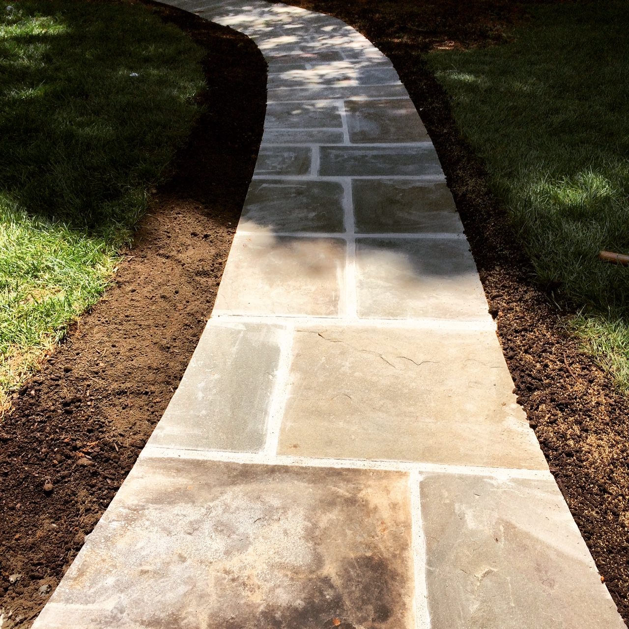 A hardscape path recently installed by LKN Turf.